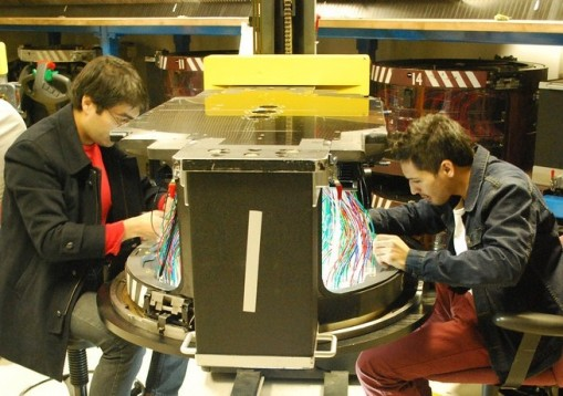 Mario and Daniel plugging fiber optics into a spectrograph plug plate