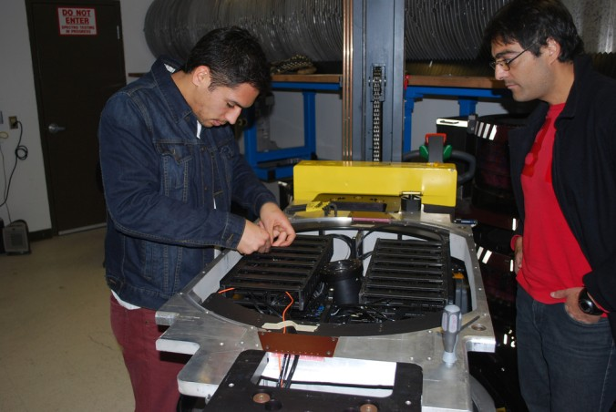 Daniel (left), Mario (right) explore the internal configuration of an APOGEE fiber optic cartridge