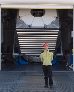 John Parejko in front of the Sloan 2.5m Telescope at Apache Point Observatory.