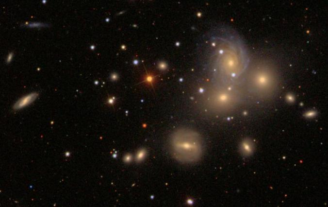 "A collection of ""spiral nebulae"". But how can we tell that they are distant galaxies rather than nearby gas clouds? Credit: SDSS"