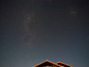 The southern hemisphere Milky Way and Large Magellanic Cloud, over the main LCO building.